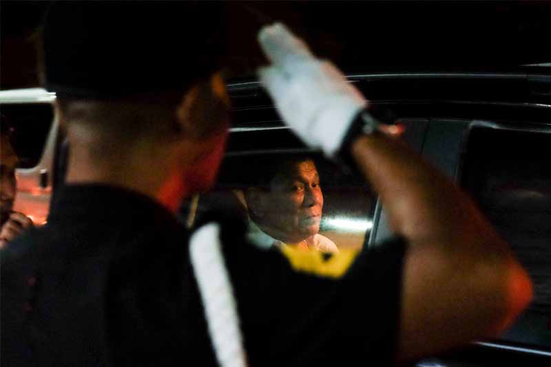 President Rodrigo Duterte prepares to alight from his vehicle upon his arrival at the New Tagum City Hall in Davao del Norte for his attendance to the birthday celebration of House Speaker Pantaleon Alvarez on January 12, 2017. Kiwi Bulaclac/Presidential Photo