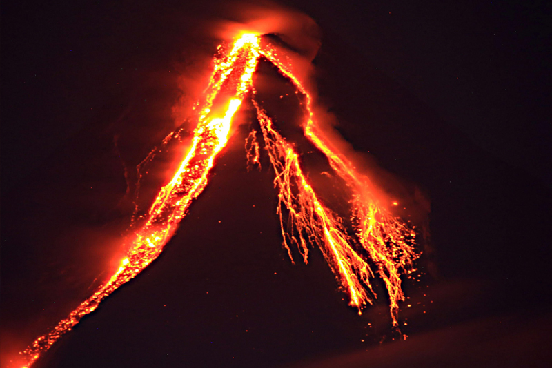 Lava cascades down the slopes of Mayon Volcano in Legazpi City, Albay the other night. Edd Gumban