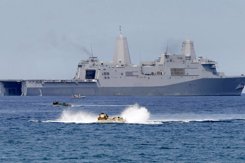 China says U.S. trespassed its waters with warship