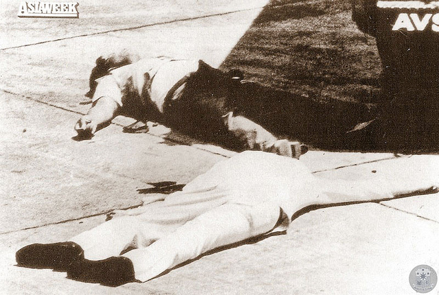 In this Aug. 21, 1983 photo, the remains of Ninoy Aquino, President Ferdinand Marcos' staunch critic, lies on the ground shortly after he alighted from the plane. Presidential Museum and Library/PCDSPO/Asiaweek