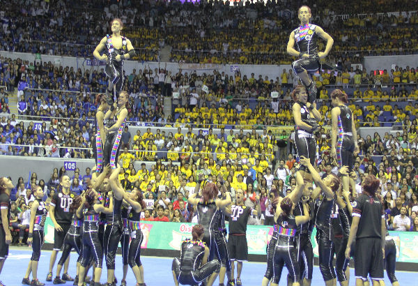 Those female muscles lifting the male cheerleaders. Photo by Emjae Villarey/philstar.com