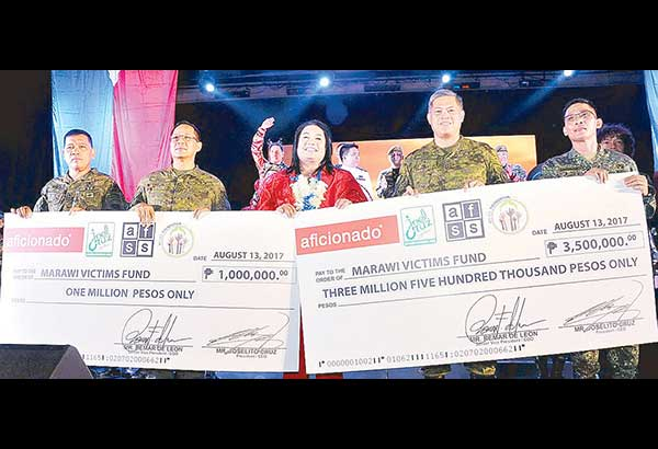 Aficionado-Perfumes and Personal Care president and CEO Joel Cruz (center) turns over the proceeds of the Awit sa Marawi concert to (from left) Civil Relations Service of the Armed Forces of the Philippines (CRSAFP) commander Maj. Gen. Ronnie Evangelista, AFP Deputy Chief of Staff Rear Admiral Narciso Vingson Jr. and AFP Vice Chief of Staff Lt. Gen. Salvador Mison Jr. with AFP Public Affairs Office chief Marine Col. Edgard Arevalo.