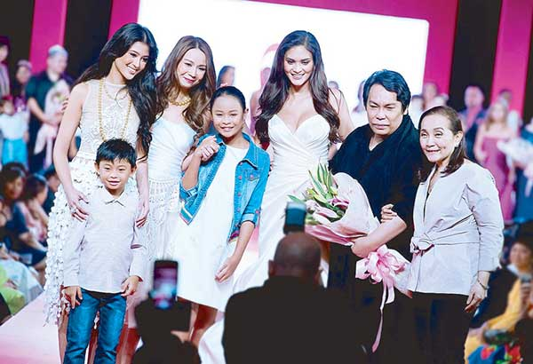At the Fashion Can Serve curtain call are (from left) Asia's Next Top Model Season 5 winner Maureen Wroblewitz, Tootsy Echauz Angara with her children Javier and Ines, Miss Universe 2015 Pia Wurtzbach, fashion designer Cary Santiago and ICanServe's Tang Singson.