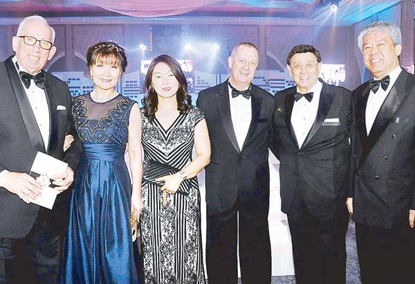 (From left) Bonifacio Landmark Realty and Development Corp. director Hans Hauri and wife Bo, Sunny Pirodon and husband, InterContinental Hotels Group regional GM for Philippines and Korea Christian Pirodon, your columnist and Dr. Elton See Tan.
