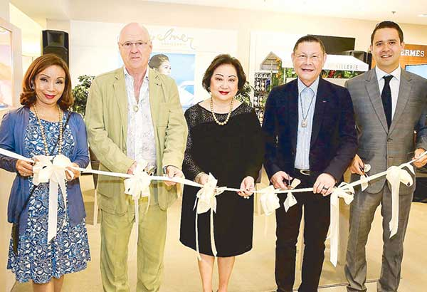 (From left) Rustan Commercial Corp. board member Maritess Tantoco-Enriquez, Jewelmer group president and CEO Jacques Branellec, Rustan Commercial Corp. chairman and CEO Nedy Tantoco with Jewelmer group chairman Manuel Cojuangco and EVP and deputy CEO Jacques Christophe Branellec lead the ceremonial ribbon cutting to open Jewelmer's newest location at Rustan's the Silver Vault.