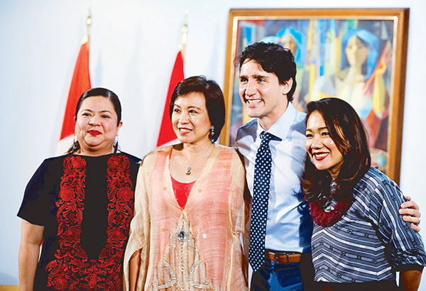 With Canadian Prime Minister Justin Trudeau are (from left) Zarah Juan, this columnist and Anya Lim.