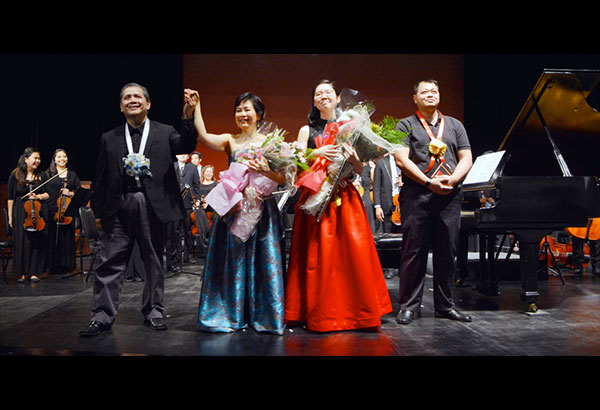 The mother-and-daughter tandem of pianist Cristine Coyiuto and flutist Caitlin Coyiuto with MMCO conductor Josefino Chino Toledo and Jourdann Petalver