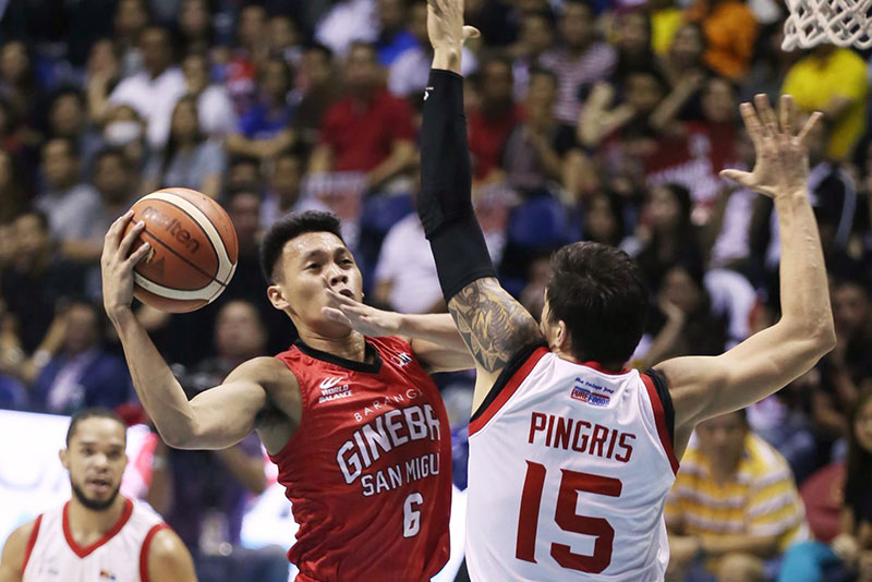 Mark Pingris of Star Hotshots puts up a solid defense against Scottie Thompson of Ginebra in Game 6 of their PBA Philippine Cup semifinal series last night at the Smart Araneta Coliseum. JOEY MENDOZA