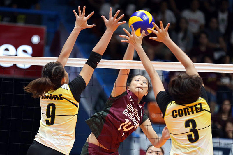 Tigresses Chlodia Eriel Cortez and Ennalie Laure team up to ward off a spike by Lady Maroon Aishalaine Gannaban in their UAAP volleyball game at the San Juan Arena yesterday. JOEY MENDOZA