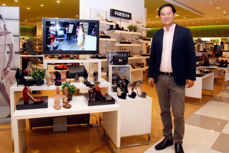 Eugene Saw: The man who strengthens SM's foothold in the shoe and bag business.