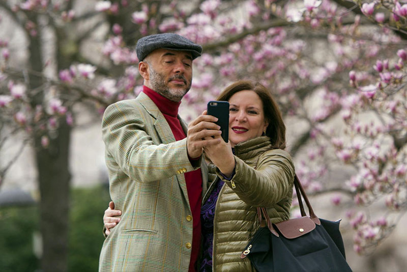 Fidelio Desbradel and his wife, Leonor take a selfie in front of a Tulip Magnolia tree in Washington. A selfie reveals more than whether it's a good hair day. A company has developed facial analytics technology to help estimate life expectancy by analyzing your face from a photo you upload online. AP