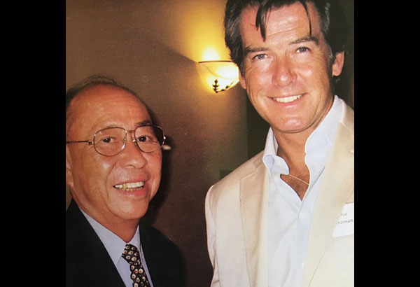 """The diplomat himself captioned this photo he had with Pierce Brosnan: """"Agent 006 meets Agent 007."""""""