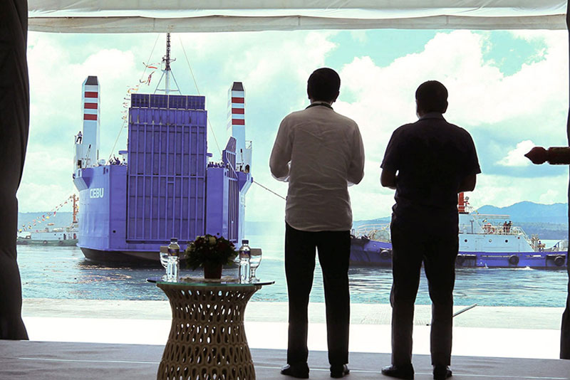 President Duterte and Indonesian President Joko Widodo watch as a roll-on, roll-off vessel sails past the Kudos Port in Sasa, Davao City during the launch of the Davao-General Santos-Bitung shipping service yesterday.