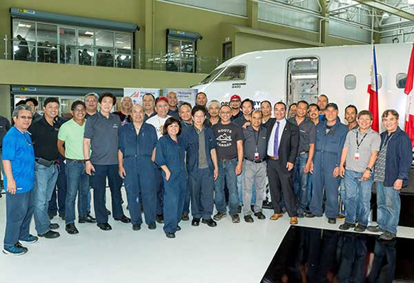 Filipino employees at Bombardier with Canadian Member of Parliament Michael Levitt. Photo courtesy of Bombardier