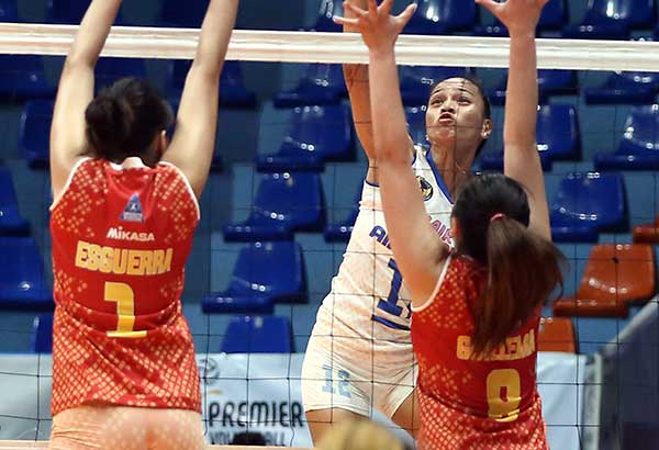 Air Force's Joy Gazelle Cases spikes through the block of Power Smashers' Mary Anne Esguerra and Vira May Guillema during their game in the Premier Volleyball League Open Conference at the Filoil Flying V Center in San Juan. MIGUEL DE GUZMAN