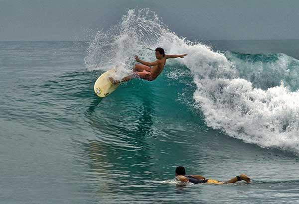 SURF'S UP: An enthusiast enjoys surfing in the waters off Siargao Island. International travel magazine Conde Nast recently picked Siargao as one of the world's top surfing destinations. GEORGE TAPAN