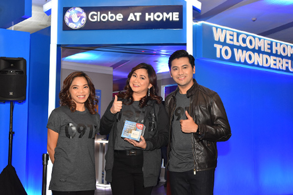 Globe At Home vice president for Marketing Barbie Dapul, senior vice president for Broadband Martha Sazon and head of Acquisitions Winsley Bangit. Globe/Released