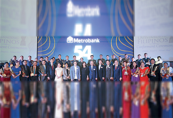 The 2016 Metrobank Foundation Outstanding Filipinos together with guest of honor Vice President Leni Robredo (front row, 10th from left); Dr. George S.K. Ty (front row, 9th from left), founder and chairman, Metrobank Group and Metrobank Foundation; Sen. Cynthia Villar (front row, 7th from left), chairperson, COPS Final board of judges; Alicia Dela Rosa-Bala (front row, 8th from left), co-chairperson, TOPS Final board of judges; Sen. Joel Villanueva (front row, 8th from right), chairperson, SOT Final board of judges; Arthur Ty (front row, sixth from left), chairman, Metrobank; Alfred Ty (front row, sixth from left), trustee, Metrobank Foundation; and Aniceto Sobrepeña (front row, sixth from right), president, Metrobank Foundation.