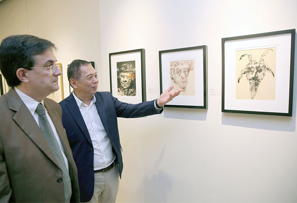 French Ambassador Thierry Mathou and Fundacion Sanso's Jack Teotico looks at the paintings of renowned artist Sanso