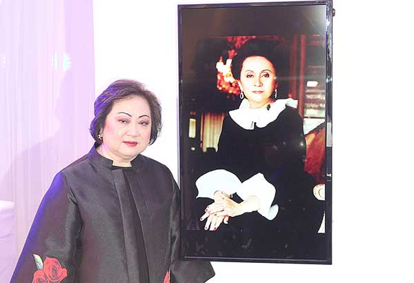 Nedy Tantoco poses with the portrait of her mom, Rustan's founder Glecy Rustia-Tantoco