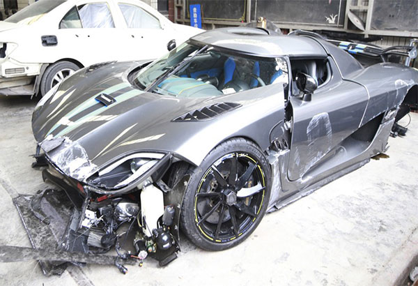 The Koenigsegg Agera R supercar which was seriously damaged in a road crash is parked at a garage in Chongqing, China, on Nov. 29, 2015. AP/Stringer/Imaginechina
