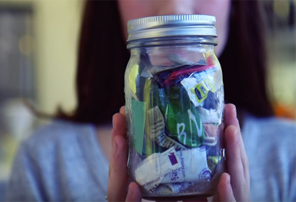 "In a video shared by ""Seeker Stories,""  Lauren Singer explains how she has produced only enough trash to fill a 16 oz. mason jar over the past two years. Youtube Screengrab"