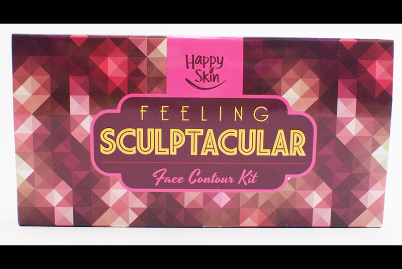 Happy trip: Feel 10 pounds lighter with Happy Skin Feeling Sculptacular contouring kit with easy-to-blend contouring and highlighting powder that sculpts the face, chisels the nose, and defines the cheeks.