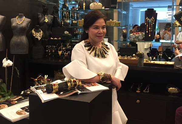 Jewelry designer Ann Ong wears a necklace from her Yamang Kalikasan collection and cuff from her Salvage Wood collection, available at the Ann Ong boutique in Shangri-La at the Fort.