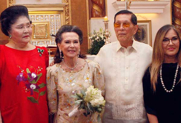 Juan Ponce Enrile, wife Cristina Enrile and daughter Katrina Enrile with long-time ally Imelda Marcos during the couple's 60th anniversary celebration. Enrile served as Defense Minister for 17 years during the Marcos dictatorship. Photos by BENING BATUIGAS