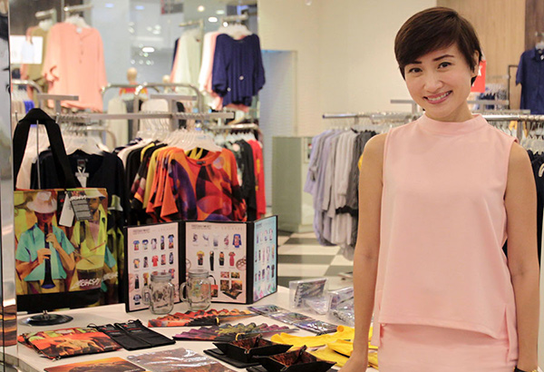 Sheree Roxas-Chua Gotuaco, CEO of Stylist in Pocket, Freeway, Ensembles, Solo, and The Row, with Freeway's National Artist Collector's series fashion and accessory line currently featuring Cesar Legaspi and Nick Joaquin. Photo by JUN MENDOZA