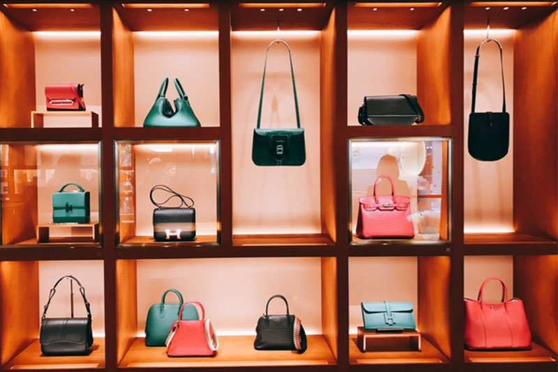 A new three-story Hermès flagship store opens at Central in Hong Kong with a retail area of 9,167 square feet. Photo shows a wall of bags displays Hermes' coveted and current icons in the store.
