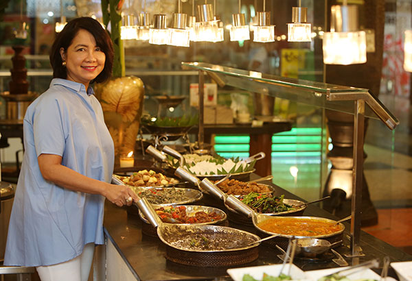 Queen of Filipino buffets: Maritel Nievera, the heart and soul behind Cabalen, is happy to share Pampanga's best in Cabalen's buffet-style dining. Photo by WALTER BOLLOZOS