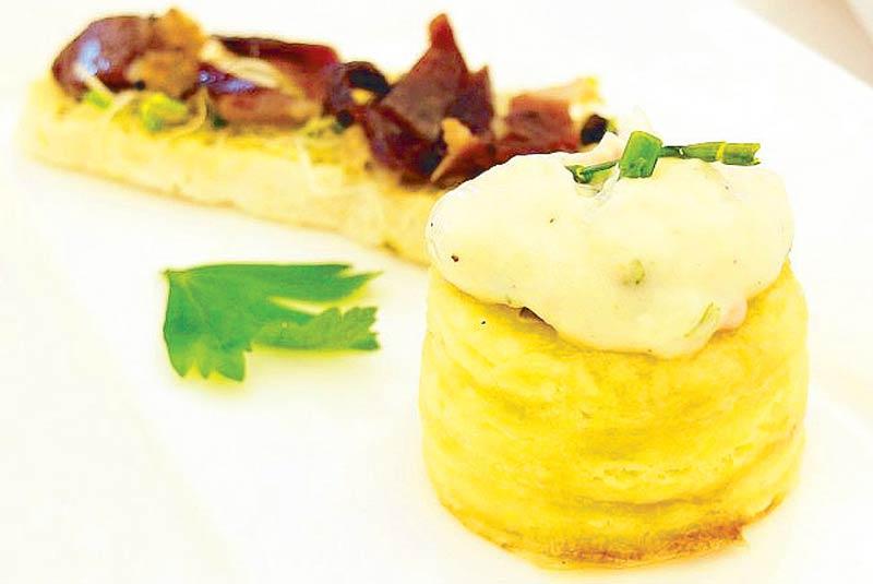 Mini vol au vent with escargots, tomato confit and cream of garlic by chef Pierre Cornelis of Vatel Restaurant in De La Salle St. Benilde Hotel.