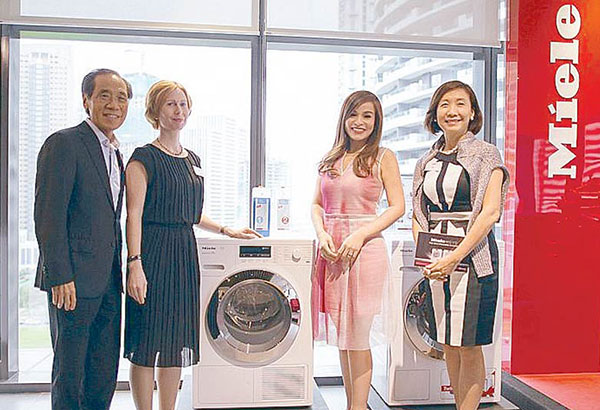 The smart washer: Miele introduces its W1 washing machine and T1 tumble dryer that have added features and the highest energy efficiency rating available on the market. In photo are Steve Sy, Focus Global  Inc. president; Frauke Nitz, Miele's export sales manager for Southeast Asia;  Grace Baja, Miele W1T1 brand ambassador; Loli Sy, Focus Global Inc. executive vice president. Photos by BENING BATIGUAS