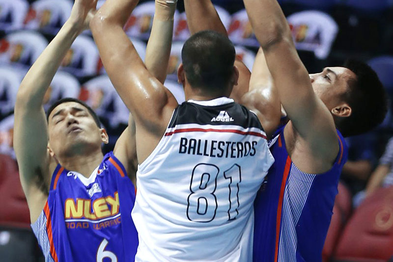 Bradwyn Guinto (6) and Kevin Alas of NLEX battle Jason Ballesteros of Mahindra for the rebound in their PBA Commissioner's Cup game last night at the Smart Araneta Coliseum. JOEY MENDOZA