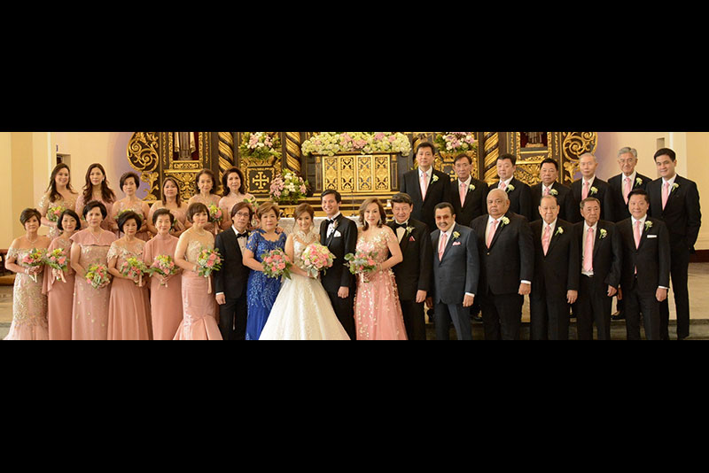 Newlyweds Sharlyn and Brian Lim (center) with their parents Dr. Henry and Susan Tan (front row, seventh and eighth from left) and Rita Lim and Dr. Henry Lim Bon Liong (front row, eleventh and twelfth from left) with the principal sponsors (front row, from left) Conchita Go, Juliet Bangayan, Katherine Tan, Lilia Villareal, Priscilla Chan, RichPrime Global Inc. president and CEO Myrna Yao, Manila mayor Joseph Estrada, executive secretary Salvador Medialdea, ambassador Carlos Chan, Larry Villareal and Alliance Global Group Inc. chairman and CEO Dr. Andrew Tan (back row, from left) Michelle Gankee, Lily Liu, Evelyn Lu, Merlyn Ong, Vilma Ang, Mary Nacague, Harry Liu, Michael Tan, Dr. William Ong, Eduardo Bangayan, Charlie Lu, Dr. Samuel Ang and Quirino Lone District representative Dakila Cua