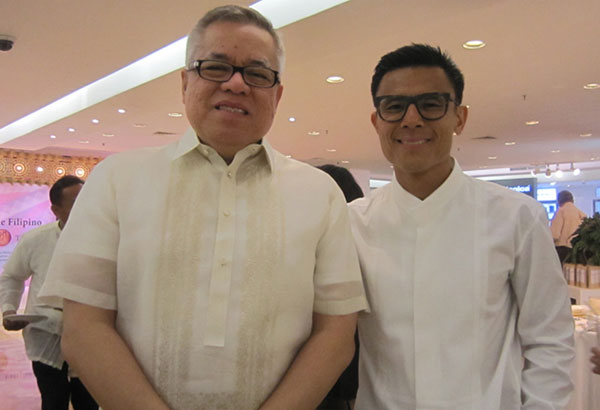 Trade and Industry Secretary Ramon Lopez and Rustan's president Donnie Tantoco