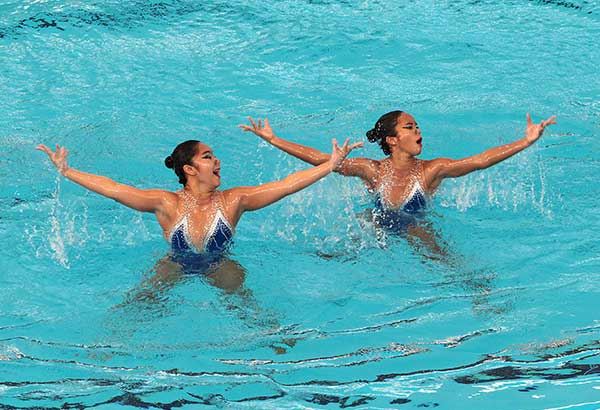 The Phl's Allysa Marey and Ruth Abiera perform during the technical routine finals in women's synchronize swimming at the Bukit Jalil National Aquatic Center in Kuala Lumpur. JUN MENDOZA