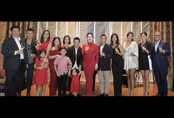 Kris Aquino is flanked by (from left) PLDT SVP and head of consumer business customer development Alex Caeg, Jericho Rosales, Bettina Carlos with daughter Gummy, Camille Prats with son Nathan, Isabel Oli-Prats, John Prats with daughter Lilly Feather, Franco Laurel, Tweetie de Leon, Maxine Medina, Pia Wurtzbach and PLDT FVP and head of home business Marco Borlongan.
