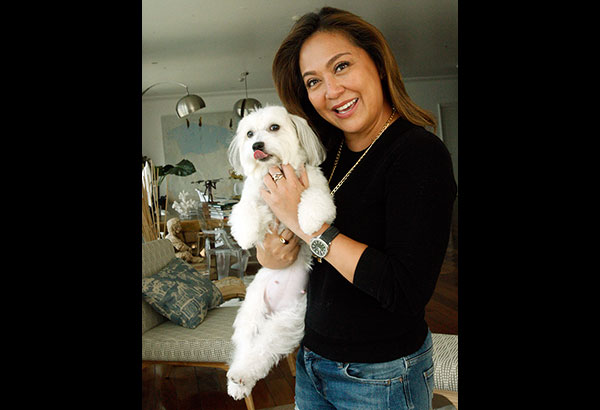 ABS-CBN's Headstart anchor Karen Davila with her New Yorker dog Lexi who brings so much joy to their home. Photos by Bening Batuigas