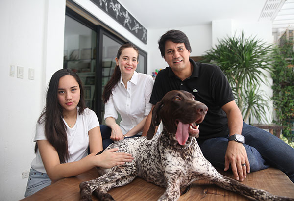 "A family affair: ""Vanilla, my German Short-Haired Pointer,  is a Philippine champion,"" says  Richard Gomez. ""Next season,  she will get enough points to  be a grand champion.""  Lucy and Juliana share  Richard's love for dogs.  Photos by JOEY VIDUYA"