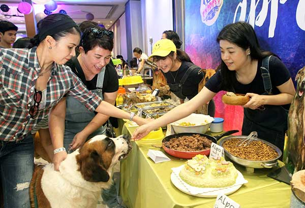 Janice de Belen with Saint Bernard Adam, Gelli de Belen, Taki Saito, and chef Giana Gonzalez at the doggie buffet. Photos by Joey Viduya, Mervin Cruz, Joana Tengson And Arne Sarmiento