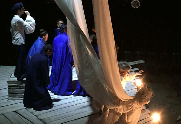 Shelter from the storm: The cast of PETA's The Tempest Reimagined simulates typhoon Yolanda onstage.