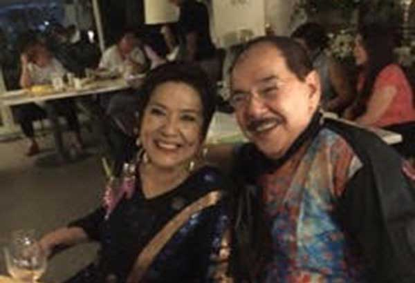 Author Barbara Gonzalez with Dr. Efren Vasquez at Happy Garden Café on the opening night of her show.