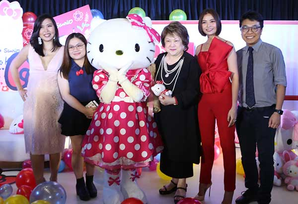 Virgie Ramos with Sanrio icon Hello Kitty, Happy Skin founders Rissa Trillo (second from right) and Jacqe Gutierrez (left), and Sanrio's Yandy Wa, licensing officer (second from left) and Ivan Wong, licensing manager (right). Photos WALTER BOLLOZOS