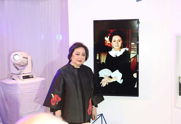 Nedy Tantoco, Rustan's chairman and CEO, beside the portrait of her mom, Rustan's founder Glecy Rustia-Tantoco