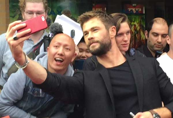 God of selfies: Chris Hemsworth indulges fans at Sydney's Hoyts IMAX red carpet with a string of selfies.