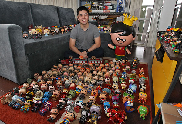 Mel Sia with his Robin (from Batman) collection and his giant Robin Funko Photos by Jesse Bustos and Mel Sia