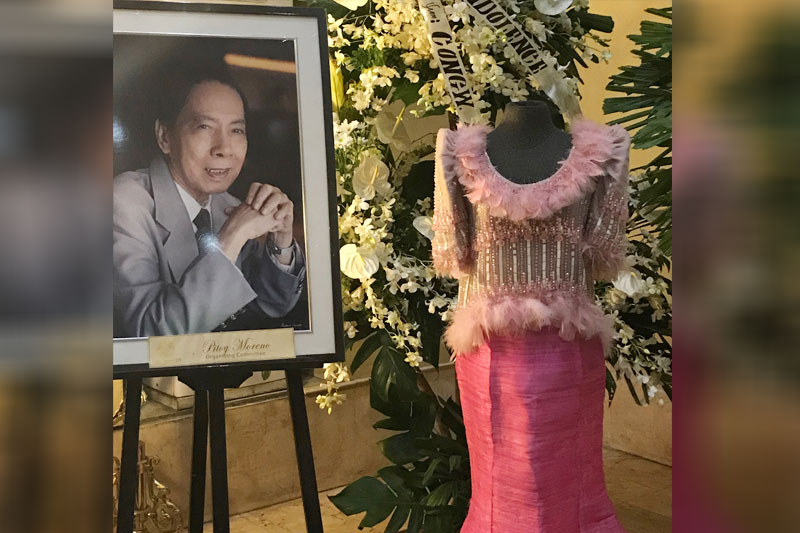 "Long live the Fashion Czar of Asia: Jose ""Pitoy ""Moreno's portrait stands beside his creation. We spotted wreaths from the children of Imelda Cojuangco, Imelda Marcos and family, Nene and Stella Araneta, Greggy and Irene Araneta, Johnny Valdez, Celia Diaz-Laurel and children, Richard and Kate Gordon, George and Kristine Yang, Ina Calalang-Ayala and Claudia Bermudez-Hyun."