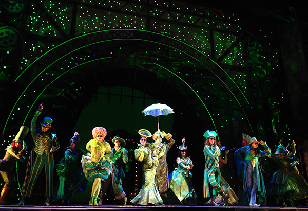 This is Oz as imagined by set designer Eugene Lee, lights man Kenneth Posner, and costume designer Susan Hilferty. If you look closely, you'll notice that everything—from the hats to the clothes to the clock—is slightly tilted. That's because everything in Oz is slightly off kilter.
